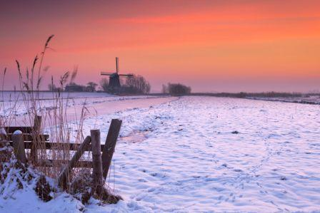 47670055 - typical dutch polder landscape with a traditional windmill. photographed in winter at sunrise.